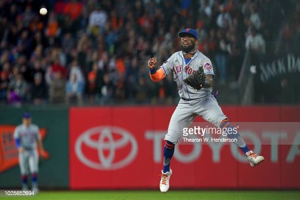 Jose Reyes of the New York Mets throws off balance to first base getting out Gorkys Hernandez of the San Francisco Giants in the bottom of the second...