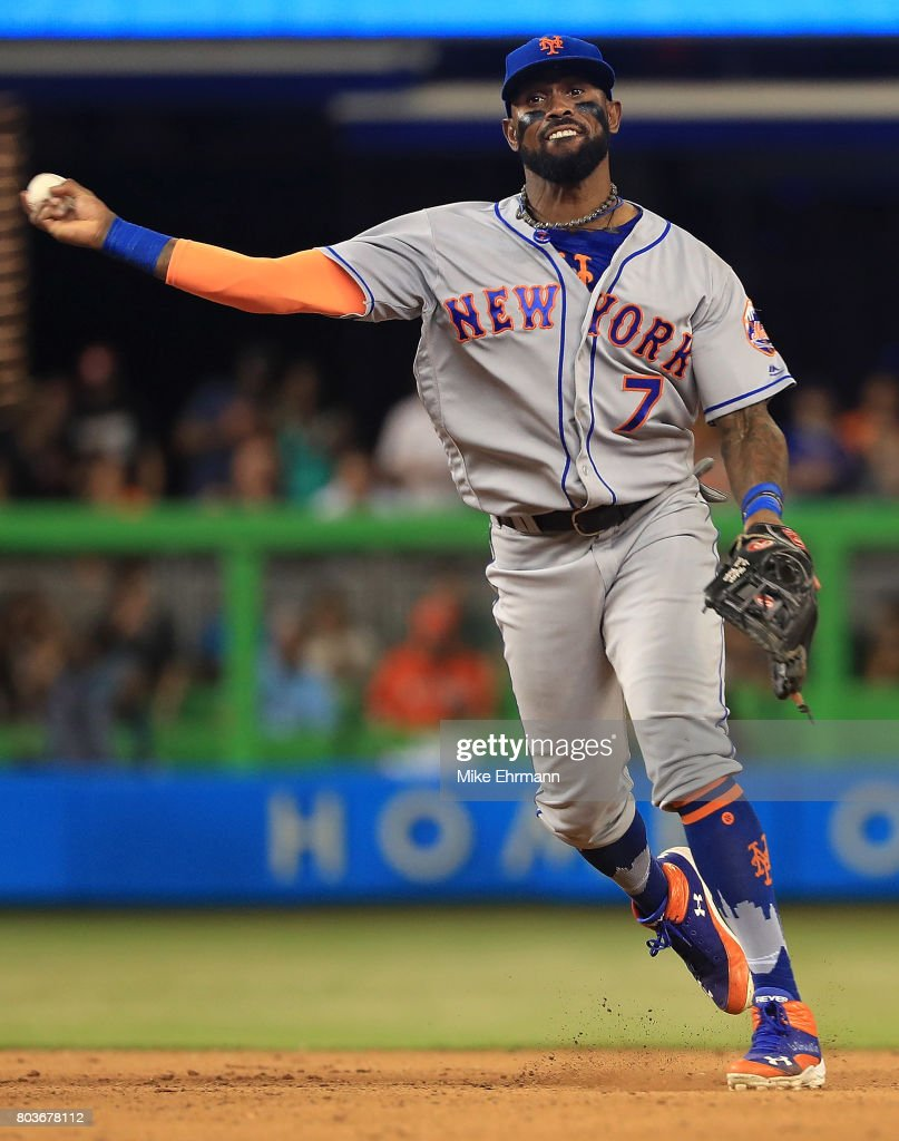 Jose Reyes #7 of the New York Mets turns a double play during a game against the Miami Marlins at Marlins Park on June 29, 2017 in Miami, Florida.