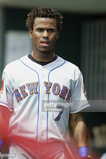 Jose Reyes of the New York Mets walks in the dugout during the MLB Game against the Cincinnati Reds at Great American Ball Park on July 1 2004 in...