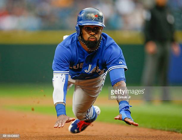 Jose Reyes of the Toronto Blue Jays advances to third on a ground out off the bat of Josh Donaldson in the first inning against the Seattle Mariners...
