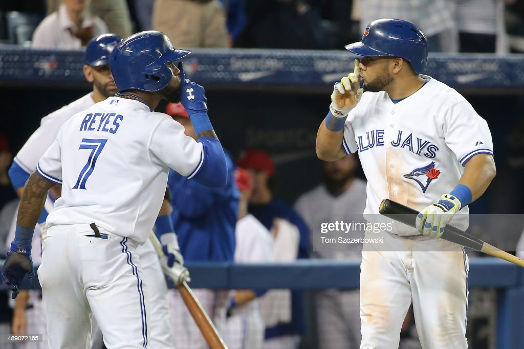 Jose Reyes #7 of the Toronto Blue Jays celebrates his solo home run with Melky Cabrera #53 in the eighth inning during MLB game action against the Los Angeles Angels of Anaheim on May 9, 2014 at Rogers Centre in Toronto, Ontario, Canada.