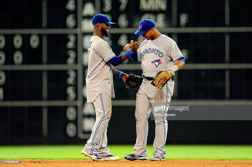 Jose Reyes #7 of the Toronto Blue Jays congratulates teammate Moises Sierra #14 following a game against the Houston Astros at Minute Maid Park on August 25, 2013 in Houston, Texas.