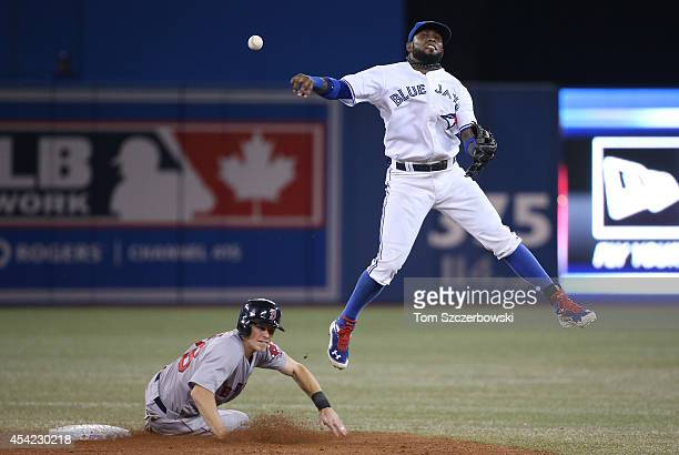Jose Reyes of the Toronto Blue Jays forces out the lead runner but cannot turn the double play in the ninth inning during MLB game action as Brock...