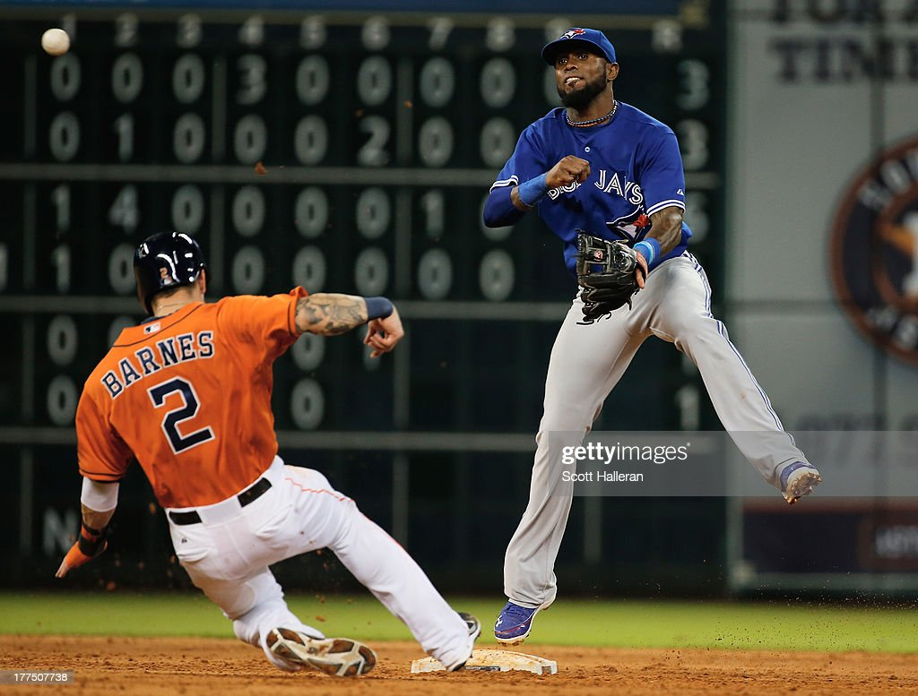 Jose Reyes #7 of the Toronto Blue Jays makes a play at second base in the fifth inning against Brandon Barnes #2 of the Houston Astros at Minute Maid Park on August 23, 2013 in Houston, Texas.