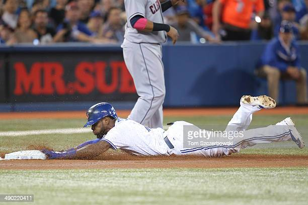 Jose Reyes of the Toronto Blue Jays slides into third base with a triple in the fourth inning during MLB game action against the Cleveland Indians on...