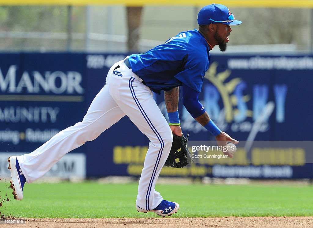 Jose Reyes #7 of the Toronto Blue Jays tosses the ball to second base for a force out during a spring training game against the Philadelphia Phillies at Florida Auto Exchange Stadium on March 2, 2013 in Dunedin, Florida.