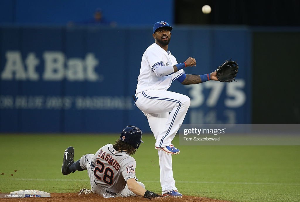 Jose Reyes #7 of the Toronto Blue Jays turns a double play in the fifth inning during MLB game action as Colby Rasmus #28 of the Houston Astros slides into second base on June 5, 2015 at Rogers Centre in Toronto, Ontario, Canada.