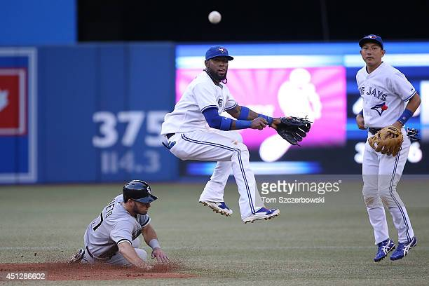Jose Reyes of the Toronto Blue Jays turns a double play in the third inning during MLB game action as Adrian Nieto of the Chicago White Sox slides...