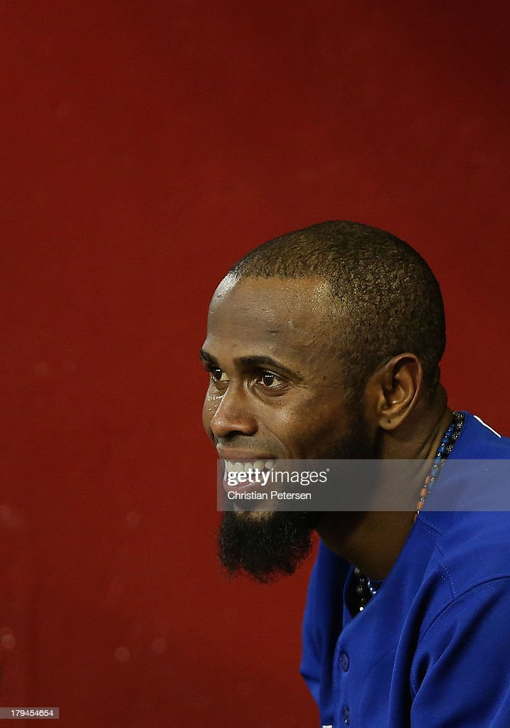 Jose Reyes #7 of the Toronto Blue Jays watches from the dugout during the interleague MLB game against the Arizona Diamondbacks at Chase Field on September 3, 2013 in Phoenix, Arizona.