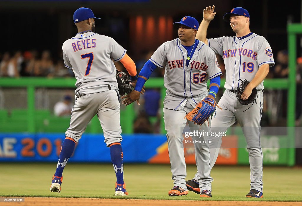 Jose Reyes #7, Yoenis Cespedes #52 and Jay Bruce #19 of the New York Mets high five after winning a game against the Miami Marlins at Marlins Park on June 29, 2017 in Miami, Florida.