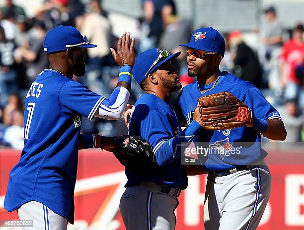 Jose ReyesDevon Travis and Dalton Pompey of the Toronto Blue Jays celebrate the win over the New York Yankees after Opening Day on April 6 2015 at...