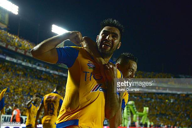 Jose Rivas of Tigres celebrates with teammate Juninho after scoring his team's third goal during a 9th round match between Tigres UANL and Monterrey...