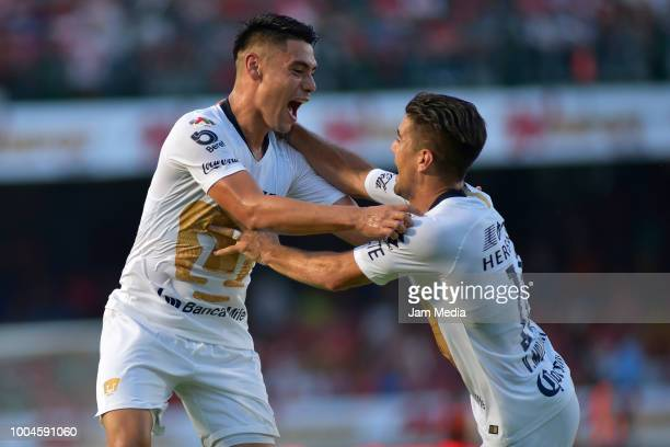 Jose Rivas of Veracruz fights for the ball with Victor Malcorra of Pumas during the 1st round match between Veracruz and Pumas UNAM as part of the...
