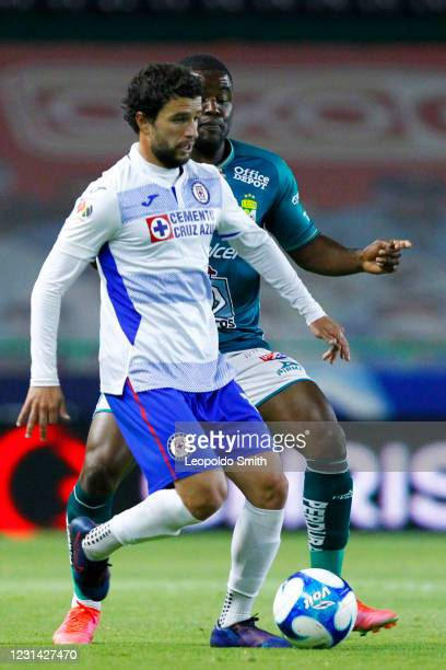 Jose Rivero of Cruz Azul competes for the ball with Joel Campbell of Leon during the 8th round match between Leon and Cruz Azul as part of the Torneo...