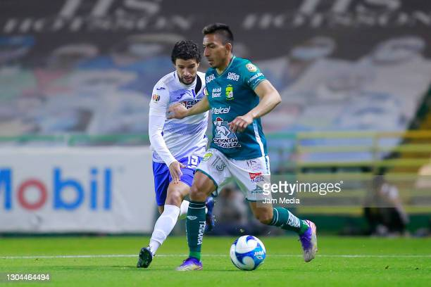 Jose Rivero of Cruz Azul fights for the ball with Angel Mena of Leon during the 8th round match between Leon and Cruz Azul as part of the Torneo...