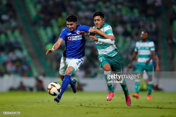 Jose Rivero of Cruz Azul fights for the ball with Omar Campos of Santos during the Final first leg match between Santos Laguna and Cruz Azul as part...