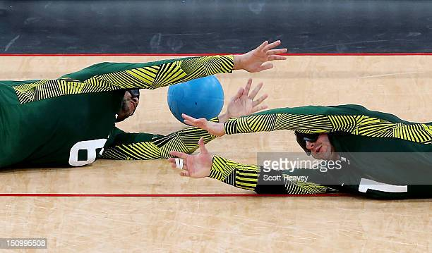 Jose Roberto Ferreira de Oliveira and Romario Diego Marques of Brazil fail to stop a goal during the Men's Group A Goalball match between Finland and...