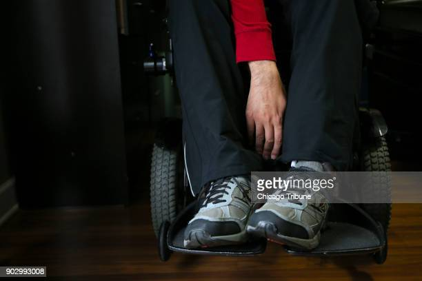 Jose Rodriguez Jr stretches his right hand while doing his daily exercises from his wheelchair at home on Wednesday Dec 13 2017 in Aurora Ill In...