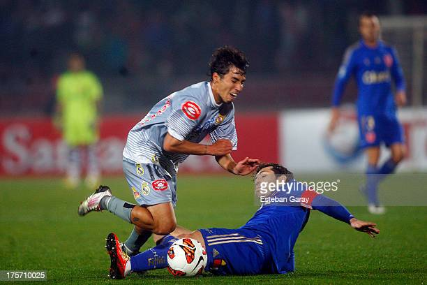 Jose Rojas of U de Chile struggles for the ball with Maximiliano Andrada of Real Potosi during a match between U de Chile and Real Potosí as part of...