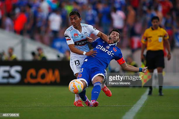 Jose Rojas of Universidad de Chile fights for the ball with Angel Mena of Emelec during a group 4 match between U de Chile and Emelec as part of...