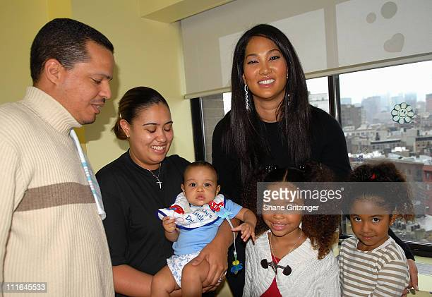 Jose Romon Kimberly Romon Jose Romom designer Kimora Lee Simmons Aoki Lee and Mingi Lee visit St Vincent's pediatric unit on November 20 2007 in New...