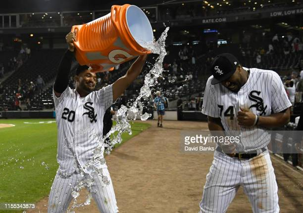 Jose Rondon of the Chicago White Sox dunks Eloy Jimenez of the Chicago White Sox after defeating the Washington Nationals 75 at Guaranteed Rate Field...