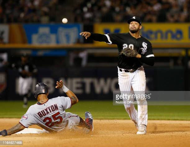 Jose Rondon of the Chicago White Sox makes a throw to first base after forcing out Byron Buxton of the Minnesota Twins out during the eighth inning...