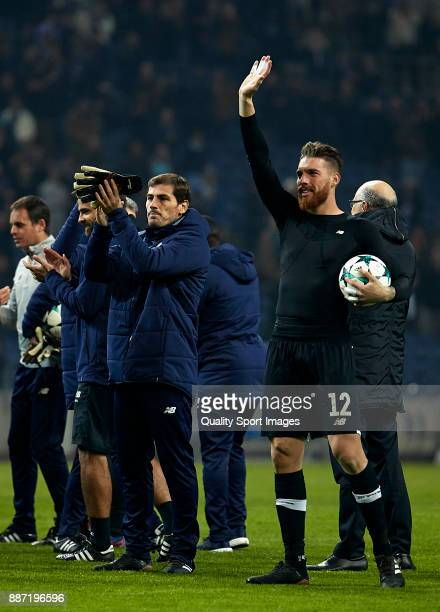 Jose Sa and Iker Casillas of FC Porto celebrate the victory with their fans after the UEFA Champions League group G match between FC Porto and AS...