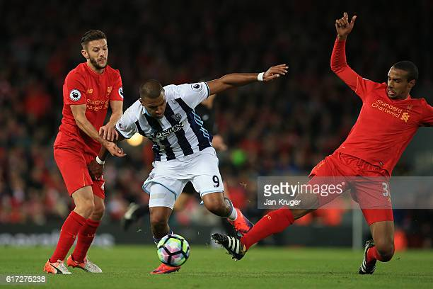 Jose Salomon Rondón of West Bromwich Albion is challenged by Liverpool duo Adam Lallana of Liverpool and Joel Matip of Liverpool during the Premier...