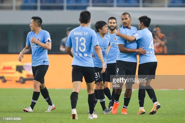 Jose Salomon Rondon of Dalian Yifang celebrates with team mates after scoring a goal during the 19th round match of 2019 Chinese Football Association...