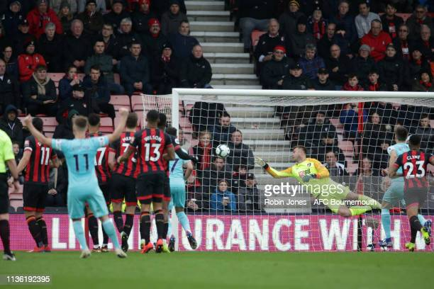 Jose Salomon Rondon of Newcastle United beats Artur Boruc of Bournemouth to make it 10 during the Premier League match between AFC Bournemouth and...