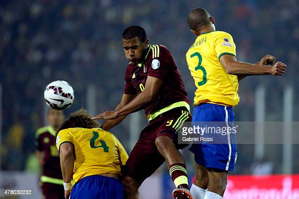 Jose Salomon Rondon of Venezuela goes for a header with David Luiz and Miranda of Brazil during the 2015 Copa America Chile Group C match between...