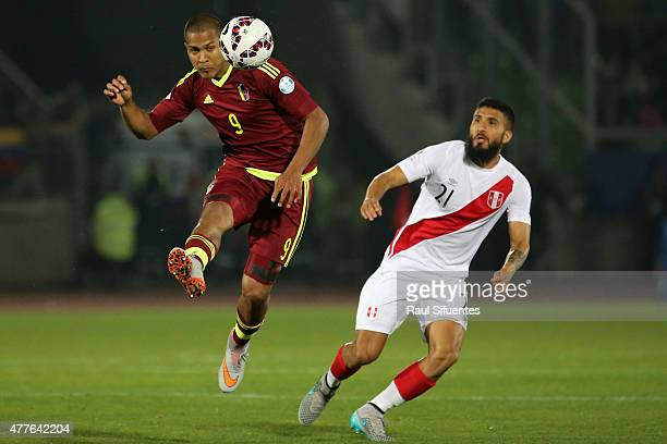 Jose Salomon Rondon of Venezuela heads the ball during the 2015 Copa America Chile Group C match between Peru and Venezuela at Elías Figueroa Brander...