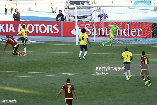Jose Salomon Rondon of Venezuela heads to score the opening goal during the 2015 Copa America Chile Group C match between Colombia and Venezuela at...