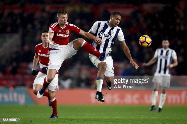 Jose Salomon Rondon of West Bromwich Albion and Ben Gibson of Middlesbrough compete for the ball during the Premier League match between...