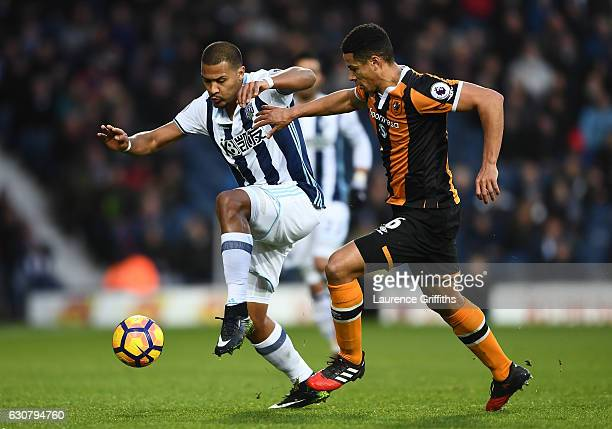 Jose Salomon Rondon of West Bromwich Albion and Curtis Davies of Hull City battle for possession during the Premier League match between West...