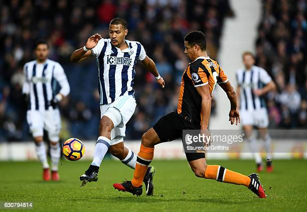 Jose Salomon Rondon of West Bromwich Albion and Curtis Davies of Hull City both stretch to reach the ball first during the Premier League match...