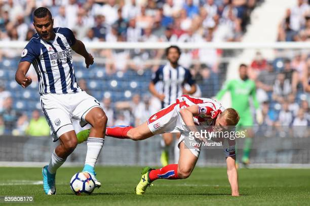 Jose Salomon Rondon of West Bromwich Albion and Darren Fletcher of Stoke City battle for possession during the Premier League match between West...