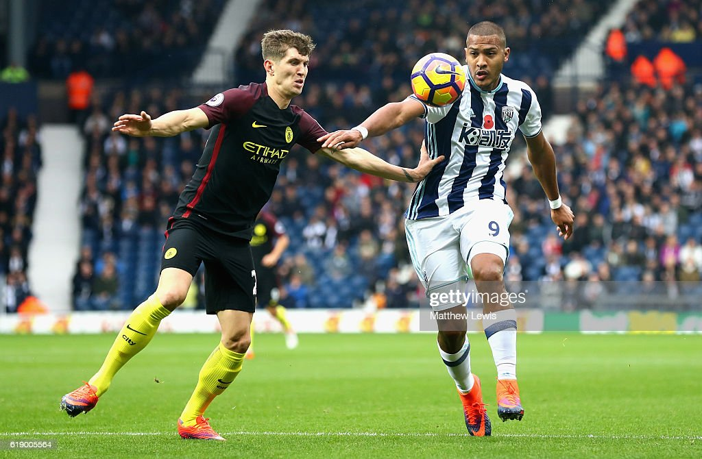 Jose Salomon Rondon of West Bromwich Albion and John Stones of Manchester City compete for the ball during the Premier League match between West Bromwich Albion and Manchester City at The Hawthorns on October 29, 2016 in West Bromwich, England.