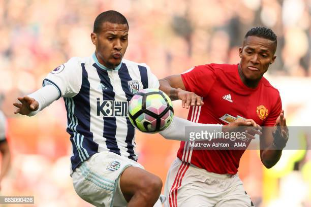 Jose Salomon Rondon of West Bromwich Albion and Luis Antonio Valencia of Manchester United during the Premier League match between Manchester United...