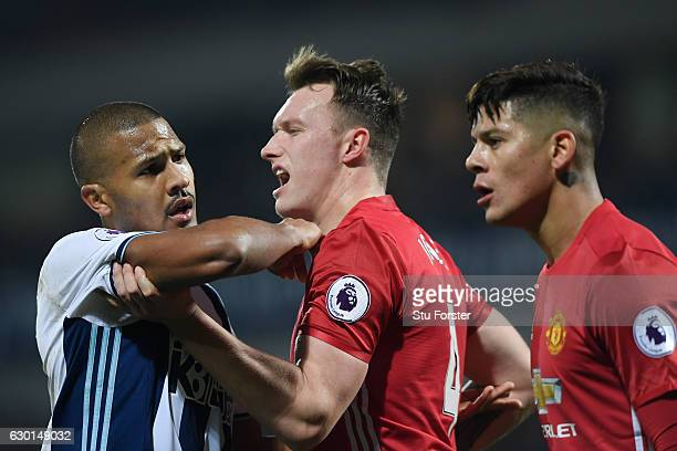 Jose Salomon Rondon of West Bromwich Albion and Phil Jones of Manchester United clash during the Premier League match between West Bromwich Albion...