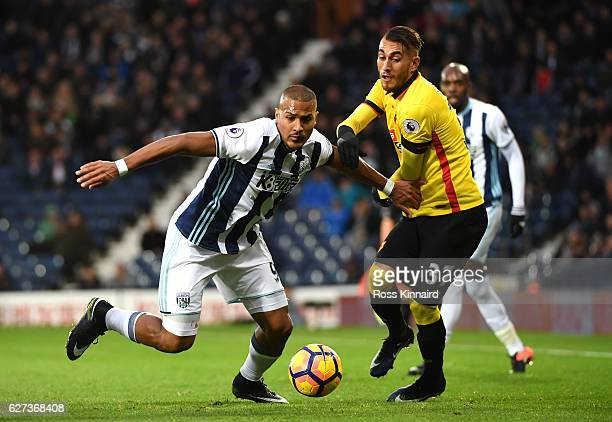 Jose Salomon Rondon of West Bromwich Albion and Roberto Pereyra of Watford compete for the ball during the Premier League match between West Bromwich...