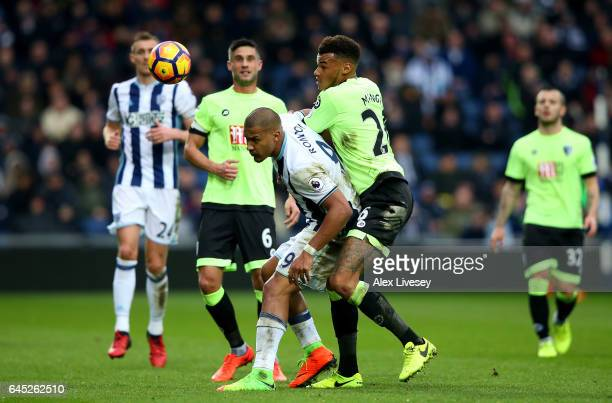 Jose Salomon Rondon of West Bromwich Albion and Tyrone Mings of AFC Bournemouth battle for possession during the Premier League match between West...