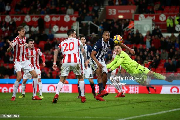 Jose Salomon Rondon of West Bromwich Albion attempts to wins a header as Jack Butland of Stoke City attempts to punch during the Premier League match...