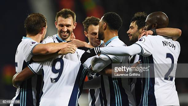 Jose Salomon Rondon of West Bromwich Albion celebrates with team mates as he scores their fourth goal during the Premier League match between West...