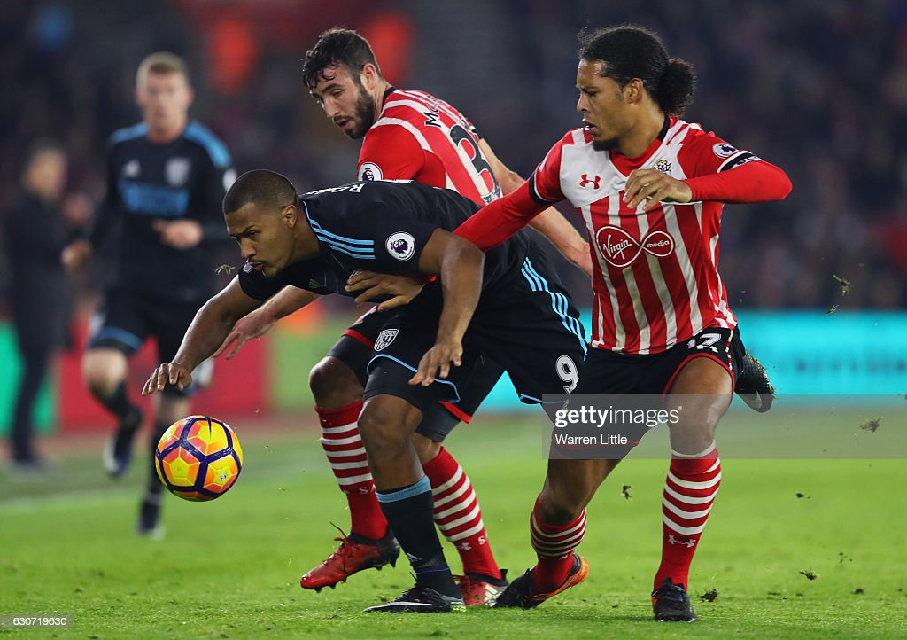 Jose Salomon Rondon of West Bromwich Albion competes against Sam McQueen and Virgil van Dijk of Southampton during the Premier League match between Southampton and West Bromwich Albion at St Mary's Stadium on December 31, 2016 in Southampton, England.