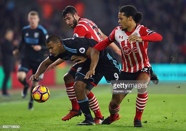 Jose Salomon Rondon of West Bromwich Albion competes against Sam McQueen and Virgil van Dijk of Southampton during the Premier League match between...