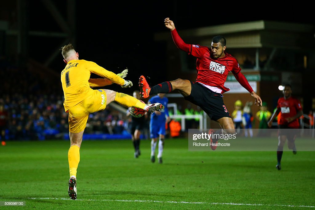 Jose Salomon Rondon of West Bromwich Albion competes for the ball with Ben Alnwick of Peterborough during the Emirates FA Cup fourth round replay match between Peterborough United and West Bromwich Albion at ABAX Stadium on February 10, 2016 in Peterborough, England.