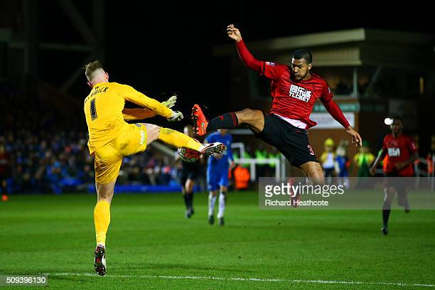 Jose Salomon Rondon of West Bromwich Albion competes for the ball with Ben Alnwick of Peterborough during the Emirates FA Cup fourth round replay...