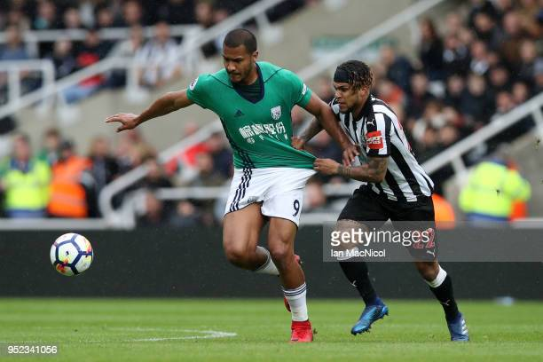 Jose Salomon Rondon of West Bromwich Albion is challenged by Deandre Yedlin of Newcastle United during the Premier League match between Newcastle...
